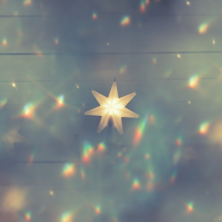 Christmas star through a crystal chandelier.