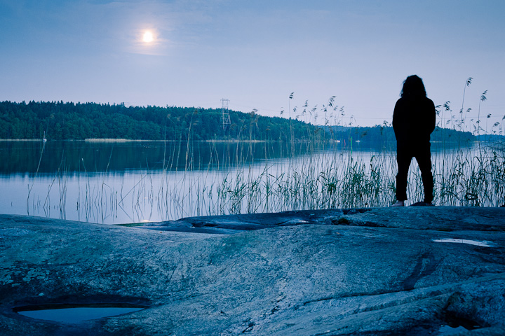 Henke on a cliff. Night light, midnight sun, blue hour. Kärsön, Mälaren, Stockholm, Sweden.