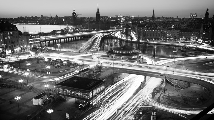 Long exposure with traffic light trails shot at Slussen, Stockholm. Cars, busses, trains and trucks painting the urban landscape with light.